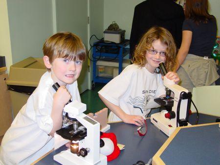 Boys with microscopes